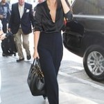 Celebrity Street Style : Selena Gomez in a black silk blouse and high waist trousers... - #StreetStyle.