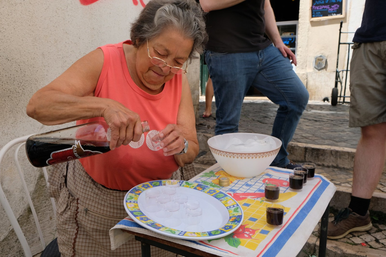 One of the cute older ladies pouring us Ginja