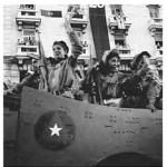 Women Cuban rebel soldiers wave on arrival in Havana, Cuba, 1959..