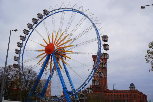 St. Marienkirche Christmas market Ferris wheel being installed, with the Rotes Rathaus in the back