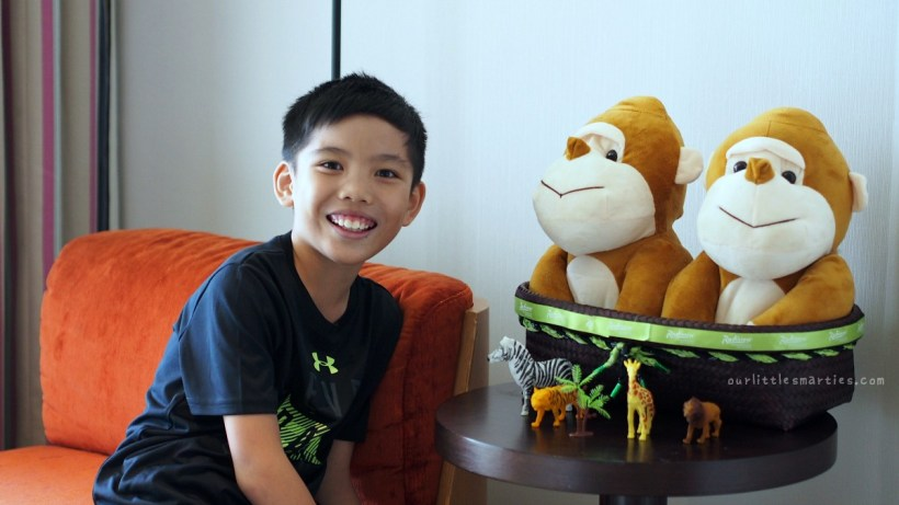 """Edison with Hotel Mascot """"Mismi"""" in his room"""