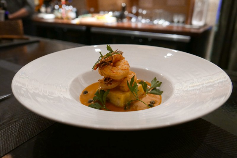 BAR MENU: Shrimp and Grits, Cheddar Grit Cake, Makahani Tomato Sauce ($12)