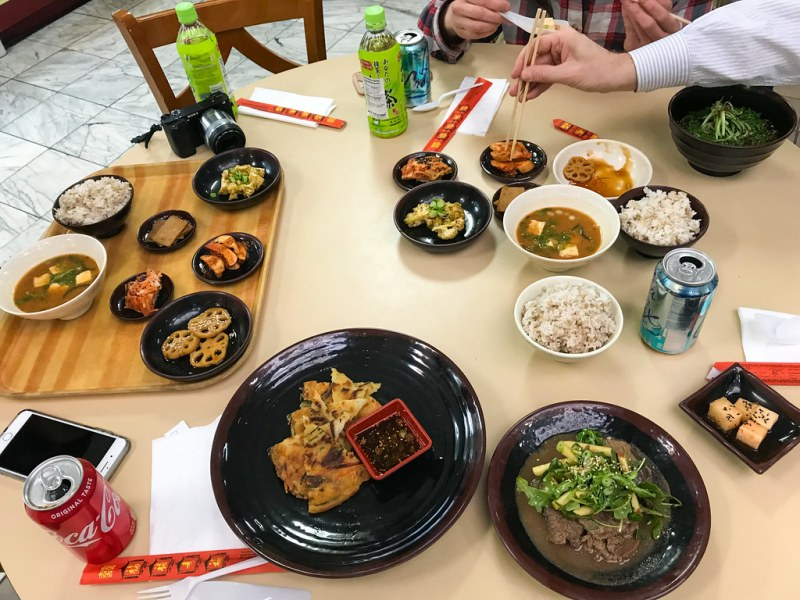 Korean Table, barley rice, chef's choice soup and assortment of side dishes ($9.75)