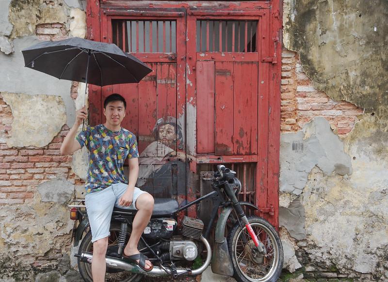 boy on motorbike street art in penang
