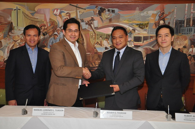 CIS Bayad Center and TrueMoney sign partnership agreement