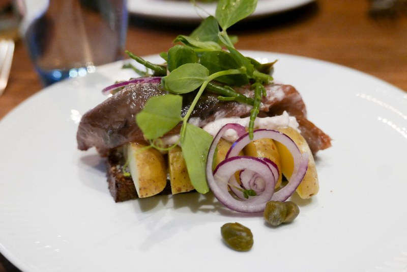 Red pickled herring, potatoes, red onion smørrebrød ($16)