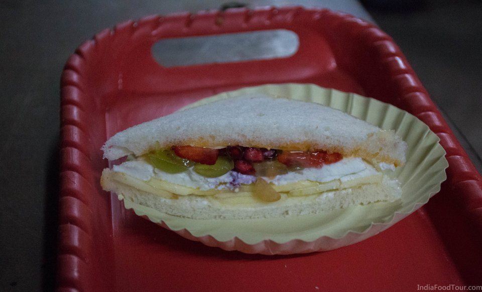 Mixed fruit sandwich with apple, pineapple, paneer, pomegranate, grapes and more