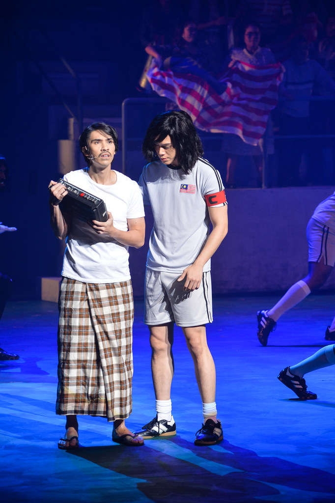 Iedil Putra as Rahman and Brian chan as _Tauke_ Chow Kwok Keong