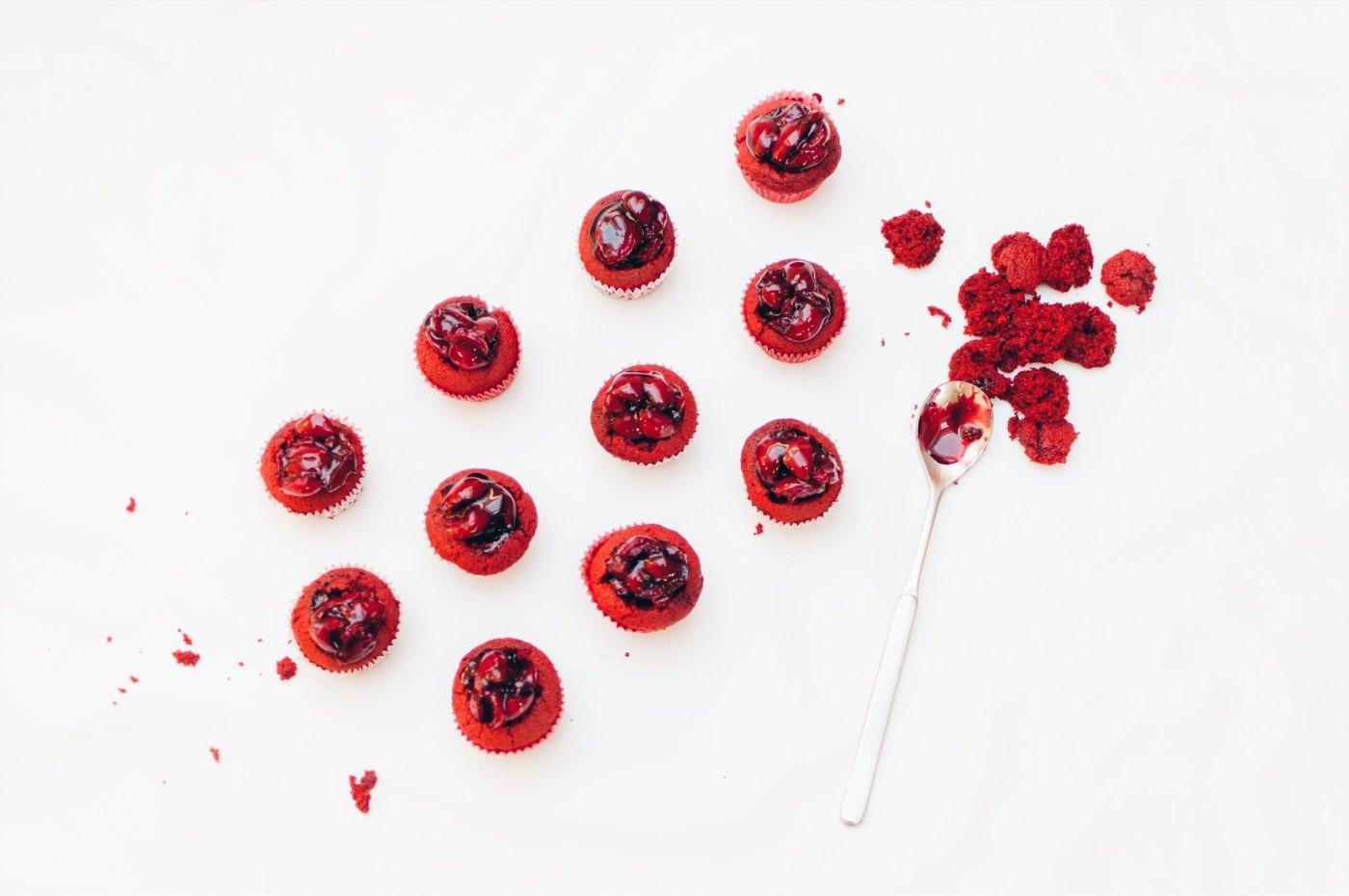 red velvet cherry bombs with cream cheese frosting and maraschino cherries