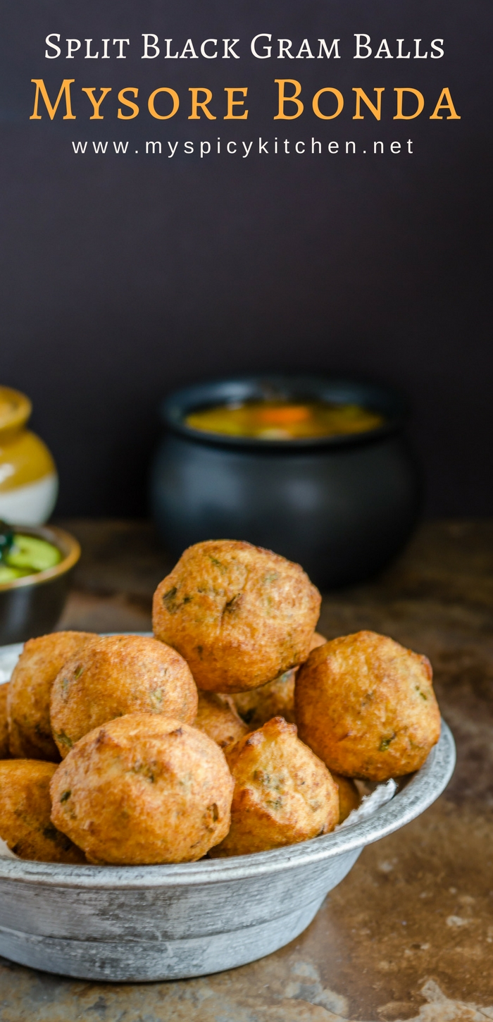 A bowl of Mysore bonda which is prepared with urad dal.  Mysore bonda is a crispy, spongy, deep fried snack made with split black lentils or urad dal and is served with coconut chutney.