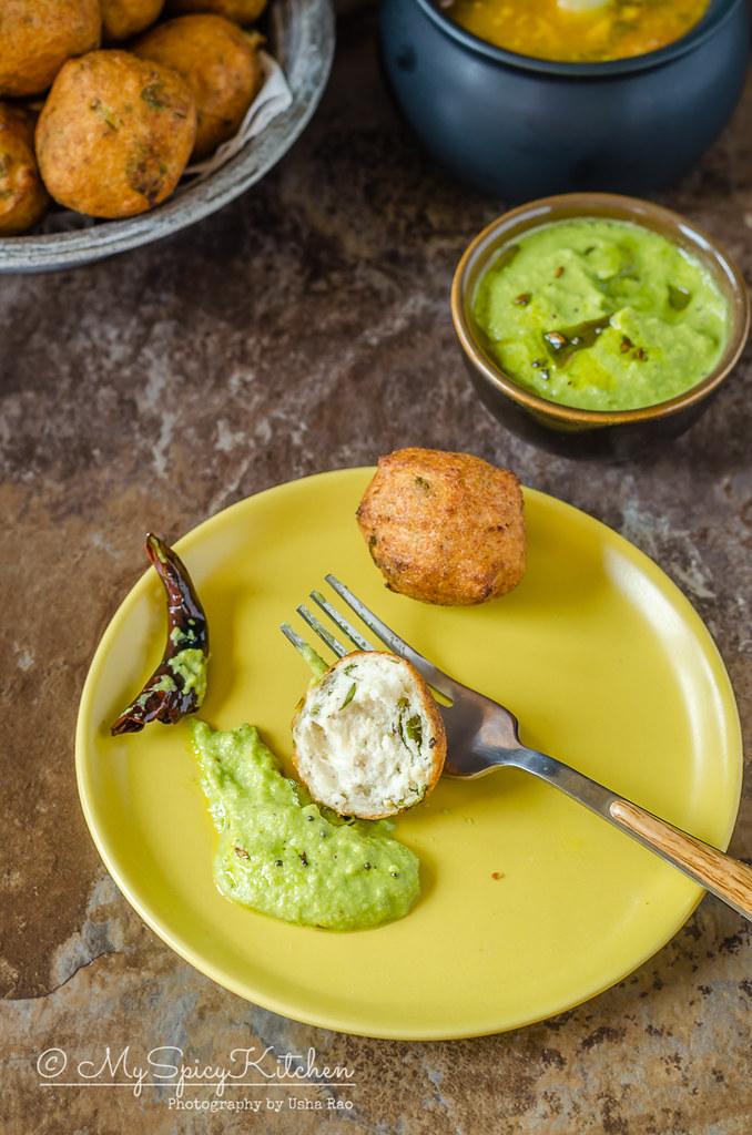 A plate of Mysore bonda with coconut chutney.  Mysore bonda is a crispy deep fried snack made with urad dal.