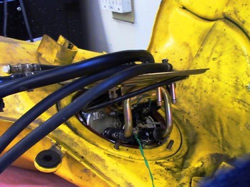 Fuel Pump Plate Partially Removed with Green Wire Tied to Vent Lines