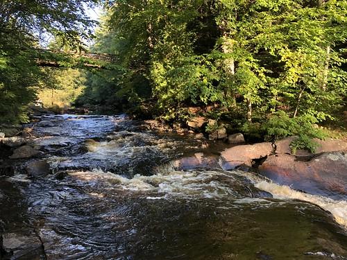 Arrowhead bridge and rapids to waterfall
