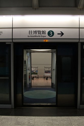 Looking through the train at at Airport station: both doors open, as there is a platform either side