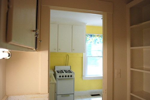 corridor to cottage kitchen before