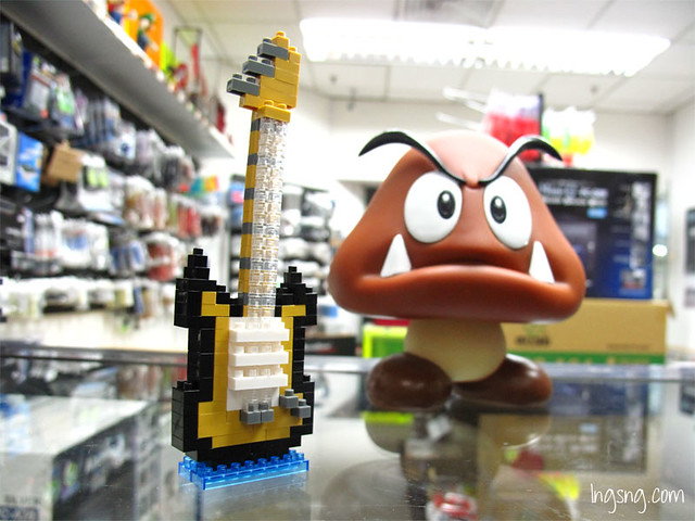 Goomba posing with Electric Guitar. Not looking very pleased. Obviously.