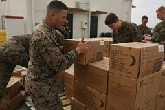 """Marines moving boxes of """"meals-ready-to-eat"""" or MREs"""