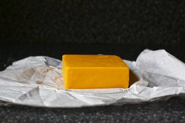 a block of orange cheese