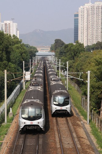 Up and down trains pass outside Fanling