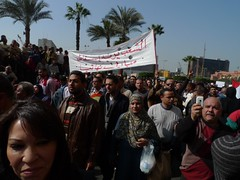 People protesting in Tahrir Square, with sign ...