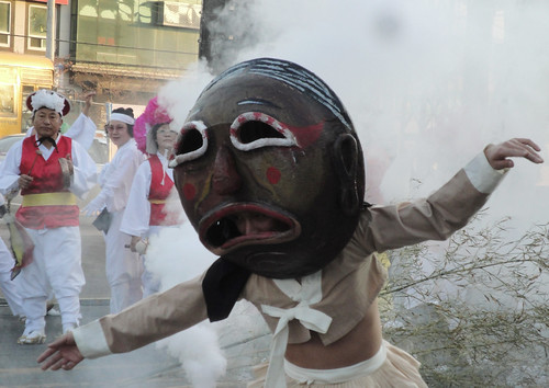 Traditional mask man in front of the fake fire
