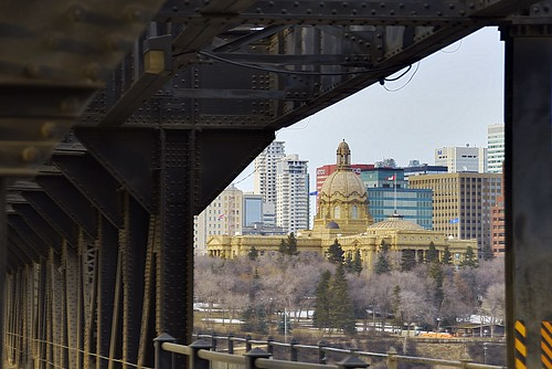 The Alberta Legislature, framed by the High Level Bridge