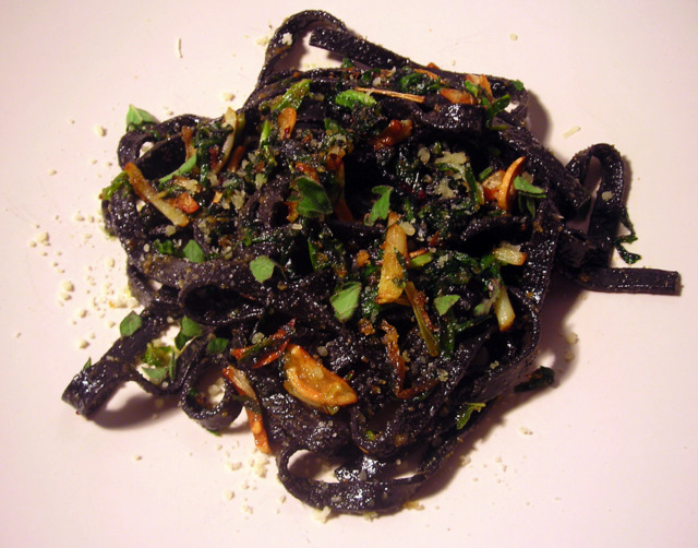 Squid ink tagliatelle with ramps, fried breadcrumbs and pecorino cheese
