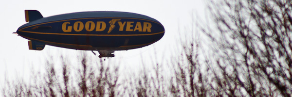 The iconic blimp passes overhead.