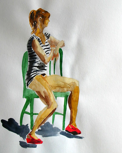 Green chair, red shoes