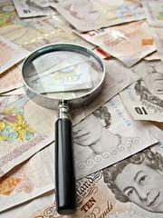 UK Pounds and magnifying glass