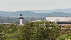 Discovery's tail fin peeks out in front of Dulles Tower