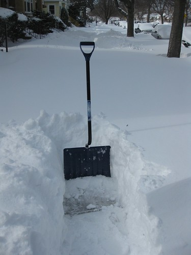 Shovel in the deep snow