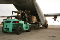 Marines load supplies for foreign humanitarian assistance missions