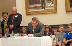 Gov. Paul LePage signs a bill that authorizes charter schools in Maine.