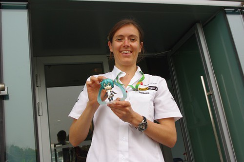 Team Sauber's staff holding Racing Miku