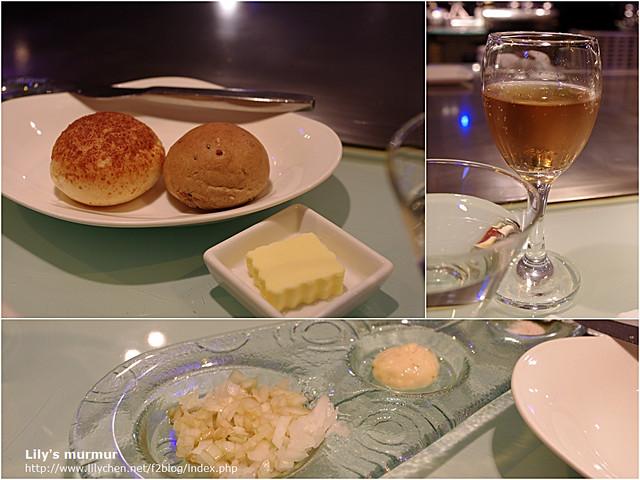 好吃的帕瑪森起司麵包及雜糧麵包,我無法克制的嗑光了。右上角是主廚招待的香檳。