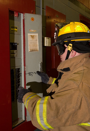 Firefighter Checks Electrical Box