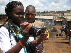 Participants in WITNESS video advocacy training practice filming on location