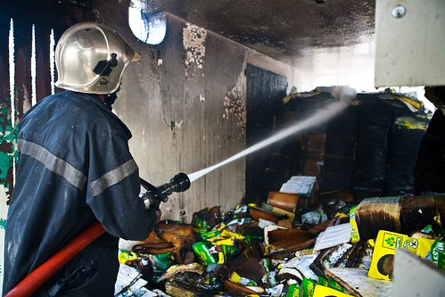 Firefighter-spraying-Posters