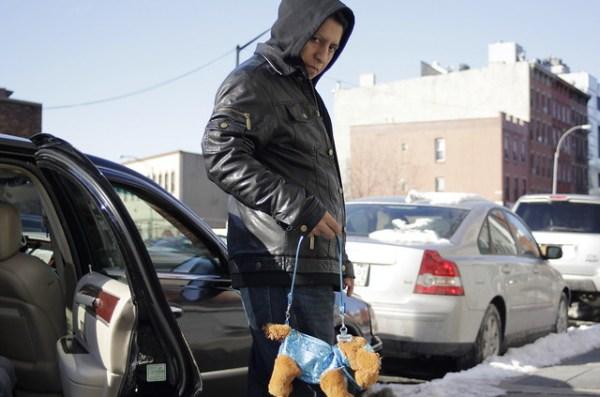 Man with dog purse