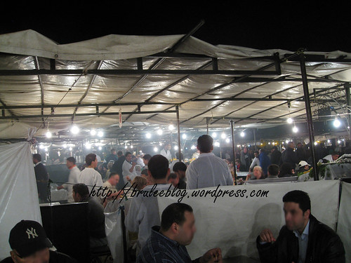 people enjoying food at the stalls