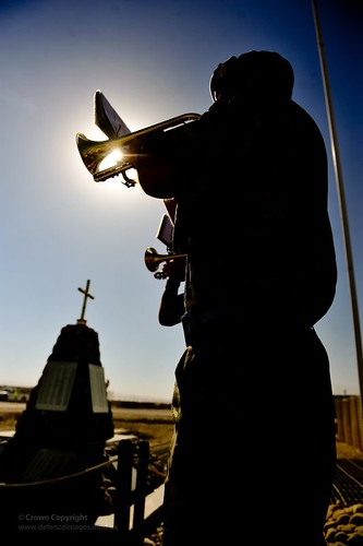A Bugler Sounds the Last Post at Camp Bastion,...