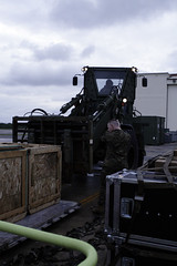 Marines load aid bound for Japan in a KC-130J