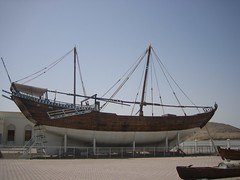An old cargo ship, now on display in a public park in Sur, Oman.  Sur was once a major trading port, and Suri ships routinely sailed to East Africa in the 19th and 20th centuries.  Now Sur depends on tourism and the oil industry.