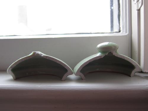 broken teapot lid on window sill