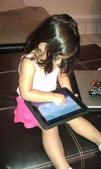 My tiny girl playing Angry Birds :).