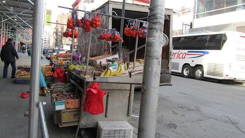 fruit vendor in Chinatown - full view