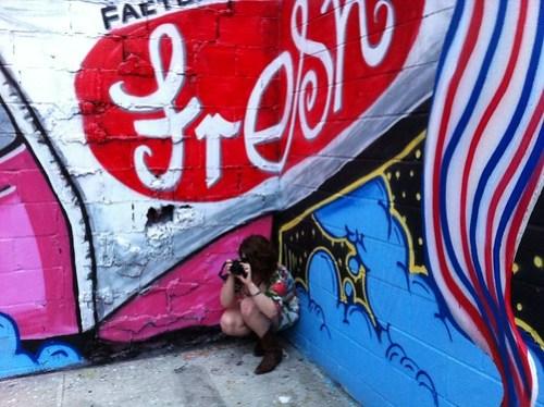 Crouching photographer at Factory Fresh