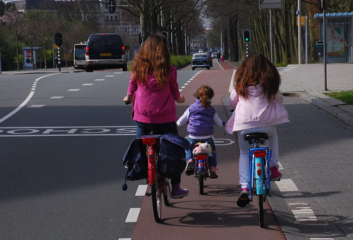 Three Little Girls On Bikes