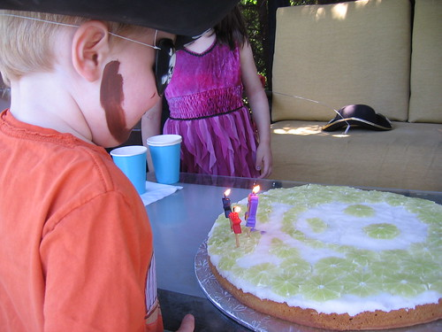 About the blow out the candles on his birthday cake.